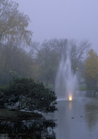 Dew Drop Pond at dusk with fountain
